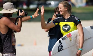 Bianca Buitendag high-fives a photographer at Snapper Rocks. Now he's allowed to do what he wants with that photo. Photo: Matt Dunbar